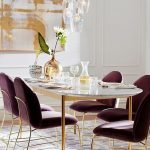 Dining Room, Wooden Floor, Purple Patterned Rug, Purple Velvet Chair, Golden Legs, White Marble Table With Golden Legs, White Wall, Glass Pendant