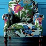 Flowery Patterned Chair, Woden Floor, Blue Wall