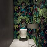 Forest Wallpaper, Grey Wall, White Floating Toilet, White Sink With Metal Support