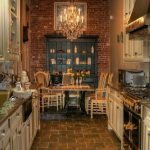 Kitchen, Brown Floor, Open Brick Accent Wall, Plain Wall, White Bottom Cabinet, Chandelier, Dining Set,