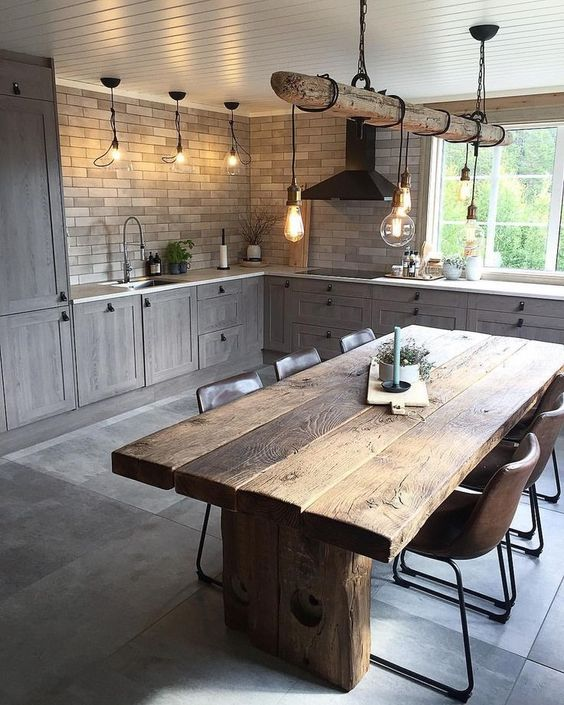 kitchen, grey floor, grey subway wall, grey wooden bottom cabinet white top, wooden dining table, brown leather chairs