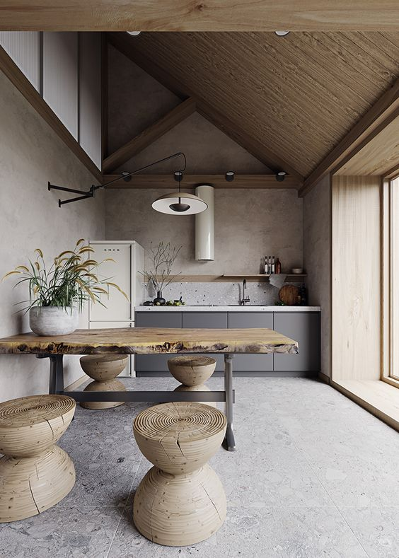 kitchen, grey floor tiles, beige wall, wooden slab table, wooden stools, wooden ceiling, grey cabinet, floating shelves, pendant
