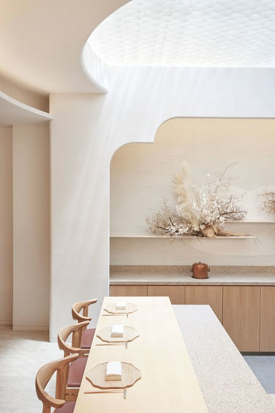 kitchen, white grey floor, white wall, curvy archs on the kitchen cabinet, brown wooden cabinet, floating shelves