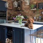 Kitchen, Wooden Floor, Open Brick Wall, Dark Blue Wooden Cabinet With White Top, Glass Pendants,