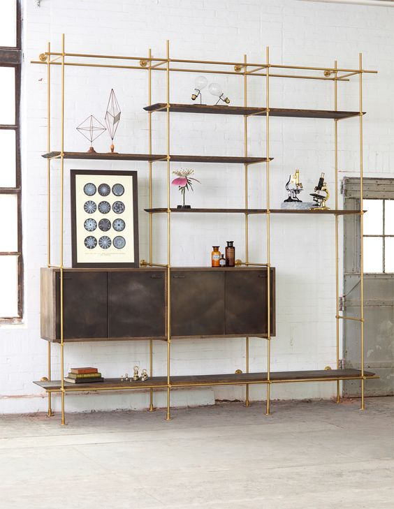 lanky golden metal shelves with dark brown boards and cabinet