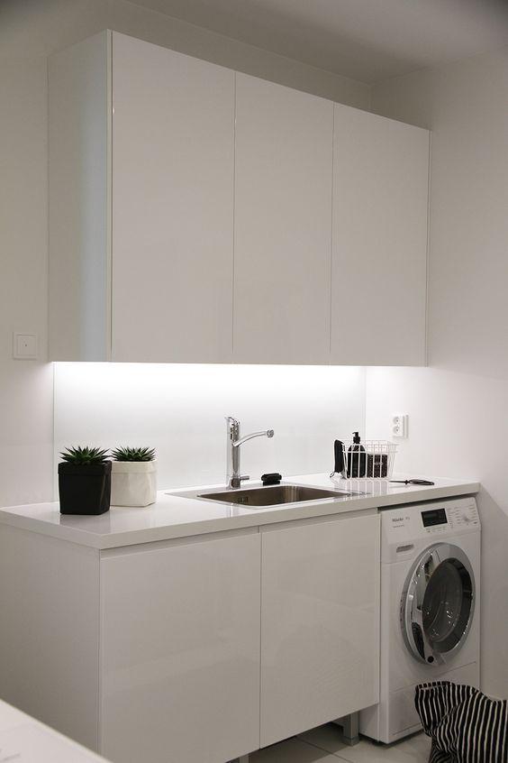laundry machine under the kitchen top, white upper cabinet, white bottom cabinet