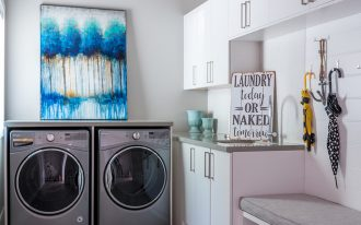 laundry room decorations blue tree painting white gloss cabinet built in bench gray countertop washing machine wooden floor umbrella hooks