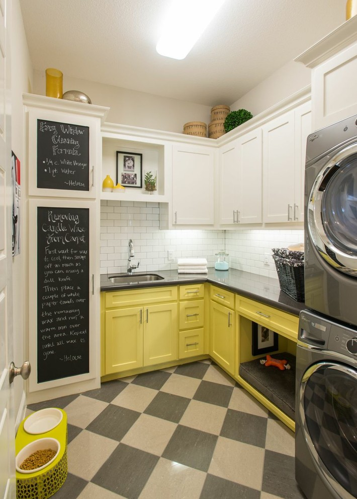 laundry room decorations chalkboard black and cream floor tile yellow and white cabinets white subway backsplash washing machine drawers