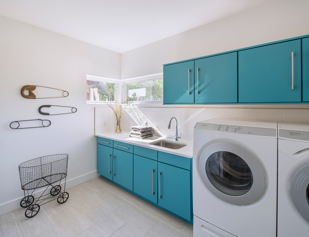 laundry room decorations glass corner windows blue cabinets white countertop big pins decorations sink faucet white walls washing machine