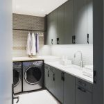 Laundry Under The Brown Top Near The Kitchen With Black Cabinet, Subway Tiles Backsplash, White Kitchen Top