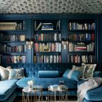 Library, Blue Wall, Blue Built In Shelves, Blue Sofa, Golden Glass Coffee Tables, Black Sconce