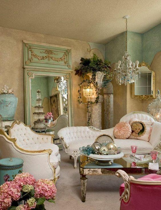 living room, beige rug, white curvy back sofa, brown wall, chandelier, pink sofa, coffee table