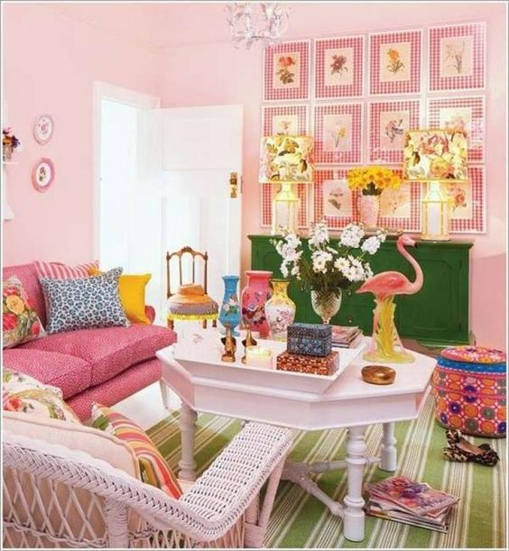 living room, green striped floor rug, soft pink wall, white hexagonal coffee table, pink sofa, white rattan chair, green cabinet