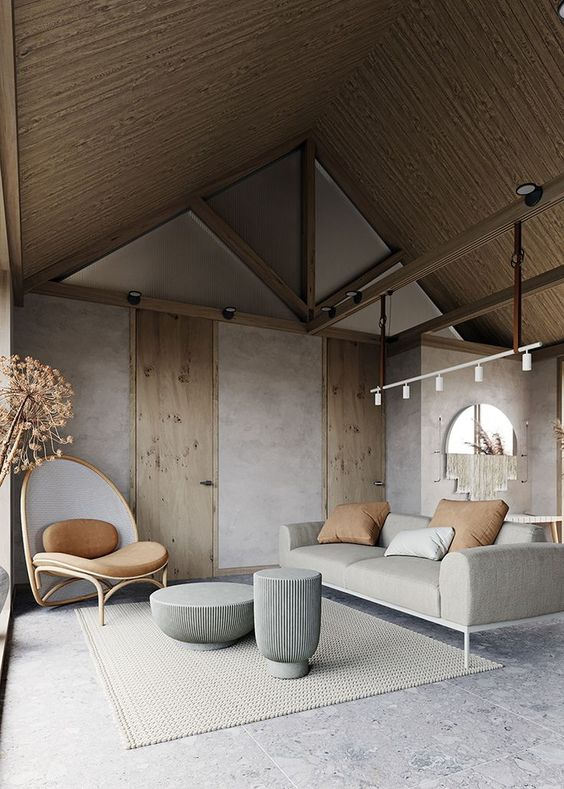 living room, grey floor, grey wall, wooden ceiling, grey sofa, curvy chair, white rug, grey coffee table