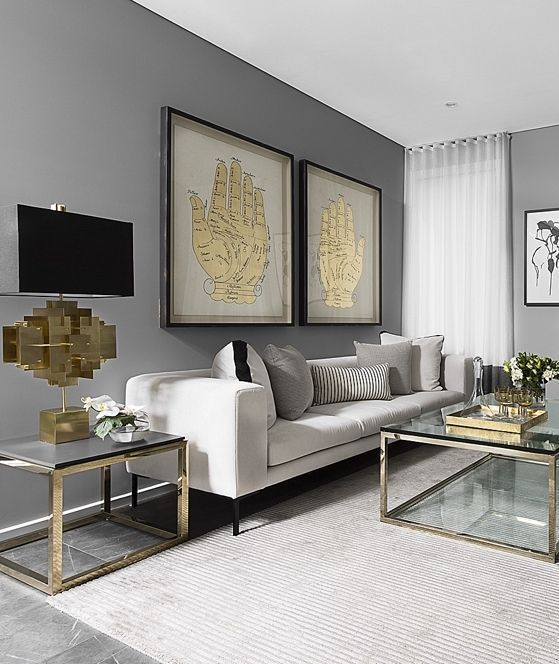 living room, grey marble, striped white rug, grey wall, white sofa, glass coffee table with golden lines