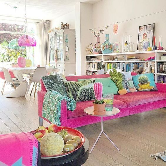 living room, pink sofa, white wall, wooden floor, white dining set, white bookshelves, tray side table