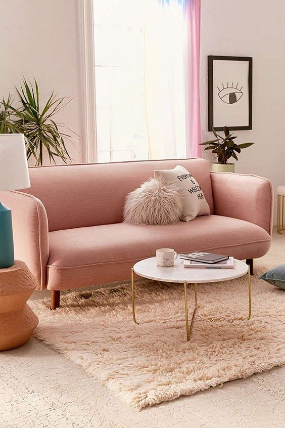 living room, white floor, pink ruf, white marble round coffee table, pink sofa, off white wall, green table lamp