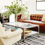 Living Room, White Floor, White Wall, Coffee Table, White Chair, Brown Leather Sofa, White Floor Lamp, Black White Plaid Rug