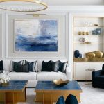 Living Room, White Floor, White Wall, White Sofa, Blue Topped Coffee Table, Black Chair, White Shelves, Golden Ringchandelier, Crystal Accent