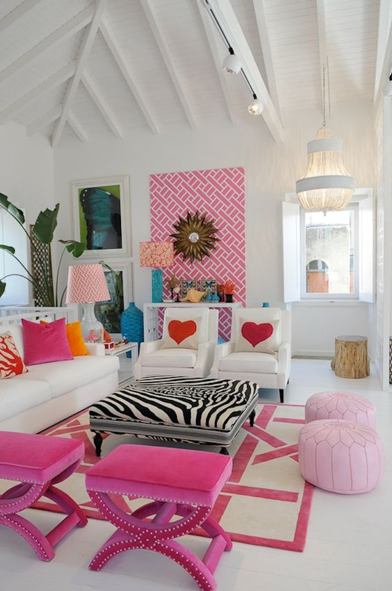 living room, white floor, white wall, white wooden vausted ceiling, white sofa, white chairs, zebra motive ottoman for coffee table, pink stools, pink ottoman, white console