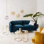 Living Room, White Rug Floor, White Wall, Deep Green Velvet Sofa, Yellow Velvet Chair, White Coffee Table