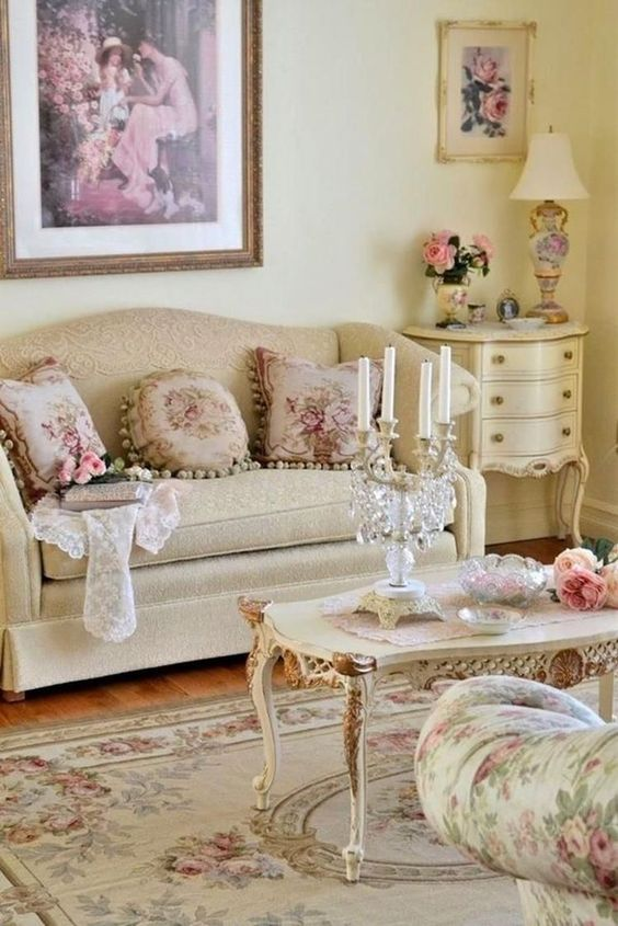 living room, wooden floor, beige sofa, white coffee table with detailed, flower chair, white side table, white table lamp