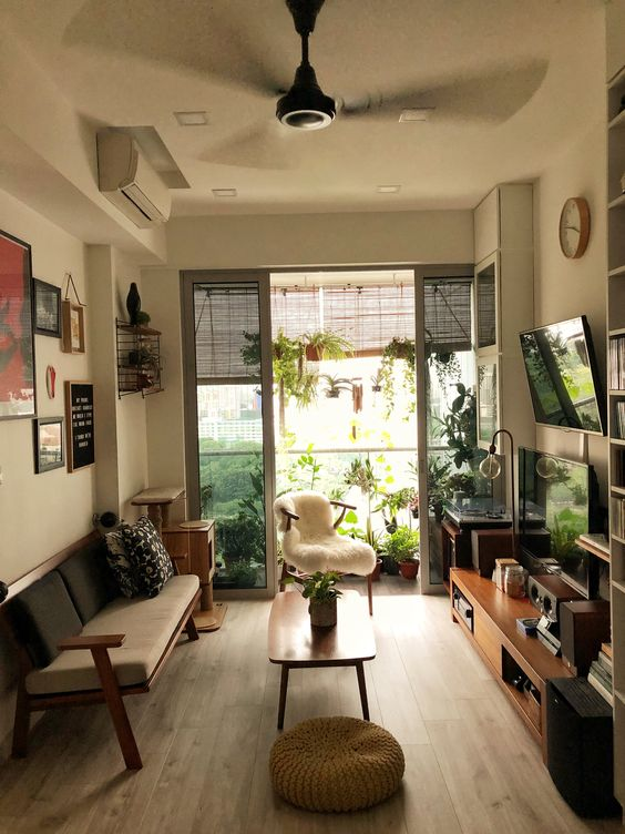 living room, wooden floor, beige wall, ceiling fan, modern wooden sofa, wooden cabinet, wooden coffee table, white chair, veranda, bamboo shade