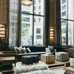 Living Room, Wooden Floor, Black Sofa, Wooden Wall, Leather Chair, Ottoman, Coffee Table, White Fur Rug
