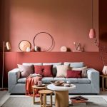Living Room, Wooden Floor, Terracotta Wall, Pink Pendant, Grey Sofa, Round Coffee Tables, Grey Rug