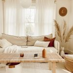 Living Room, Wooden Floor, White Rug, Wooden Rattan Table, White Sofa, Rattan Basket, White Wall, White Globe Pendant