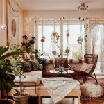 Living Room, Wooden Floor, White Wall, Hanging Plants, Wooden Bench, White Cushion, Rattan Chair, Glass Chandelier, Ottoman