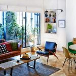 Living Room, Wooden Herringbone Floor, White Wall, Brown Leather Sofa, Blue Chair, Wooden Coffee Table, White Built In Shelves, Brown Rug, Dining Set