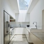Long Clear Glass On The Kitchen's Ceiling, White Wall, White Upper Cabinet, White Bottom Cabinet, Brown Marble Floor