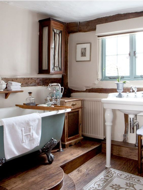 modern bathroom, wooden floor, white wall, blue framed window, blue tub, floating clothe, white sink