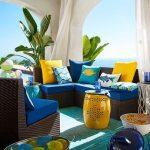 Patio, Green Blue Rug, Dark Brown Rattan Sofa, Dark Blue Cushion, Blue Yellow Pillows, Pendant, Yellow Pillo