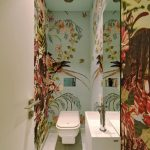 Powder Room, White Marble Floor, White Thin And Long Vanity, White Toilet, Flowery Wallpaper