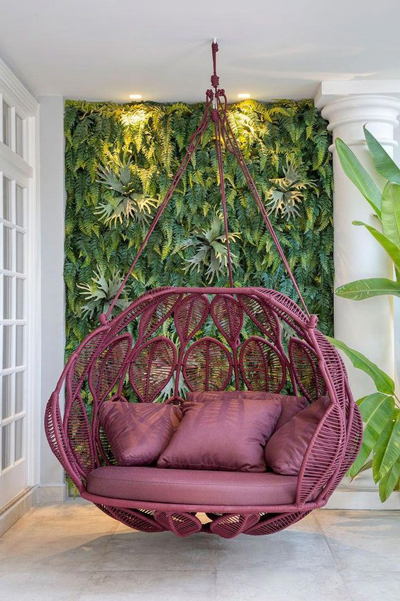 purple rattan leave shaped swing, purple cushion, outdoor swing, white wall