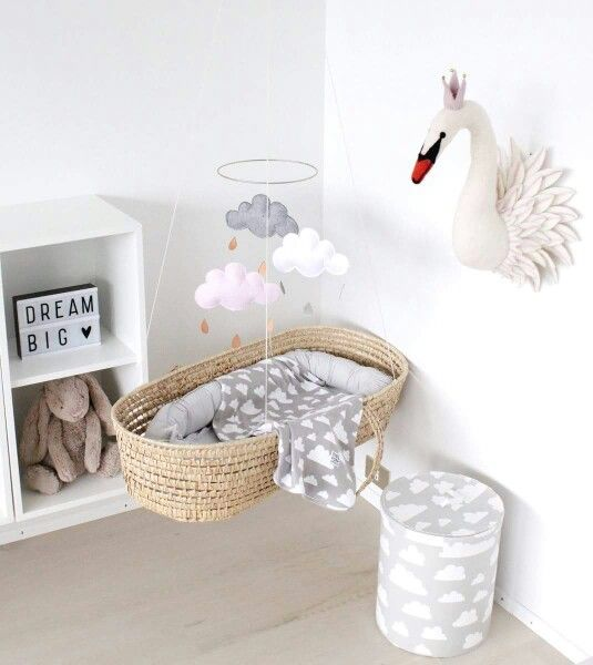 rattan bed swing, hung from ceiling, white wall light wooden floor, white shelves