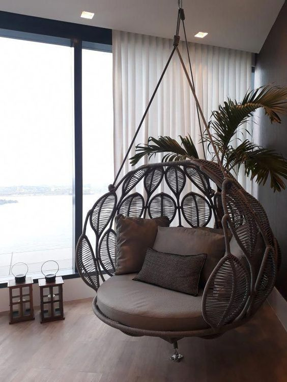 rattan leave shaped swing, brown cushion, brown pillows