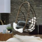 Rattan Swing, White Fur Cushion, Wooden Floor, Wooden Coffee Table, White Table, Animal Pattern Rug
