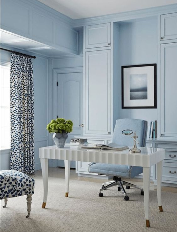 study room, blue wall, white table, blue office chair, off white rug