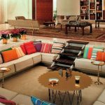 Sunken Living Room, Beige Floor Rug, Bilt In White Sofa, Dark Wooden Stairs, Round Coffee Table, Tray Tables