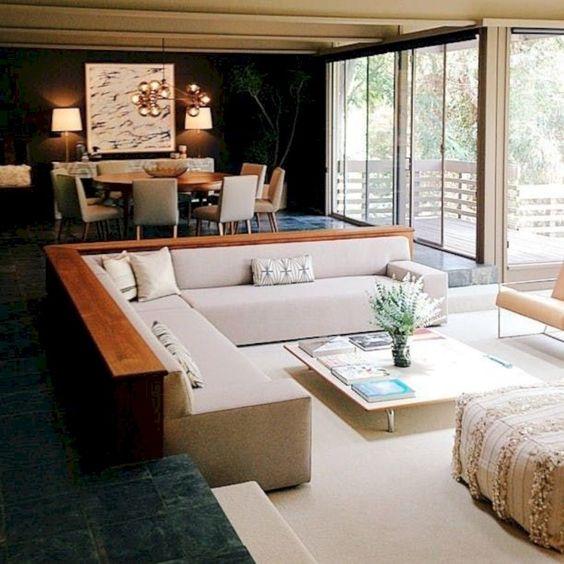 sunken living room, white pit floor, black marble floor, wooden rim, white corner sofa, white low coffee table