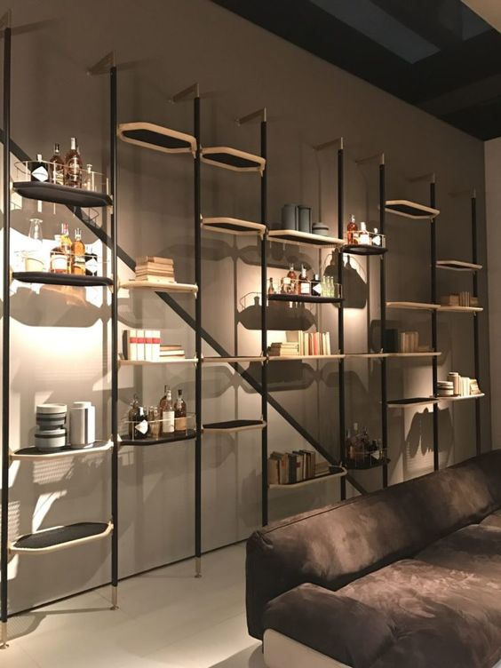 wall shelves with black metal support, black hexagonal tray, brown wall, brown floor, dark brown sofa