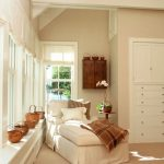 White Lounge Chair, Beige Floor, Beige Wall, White Built0in Cabinet, White Window Bay, Large Window