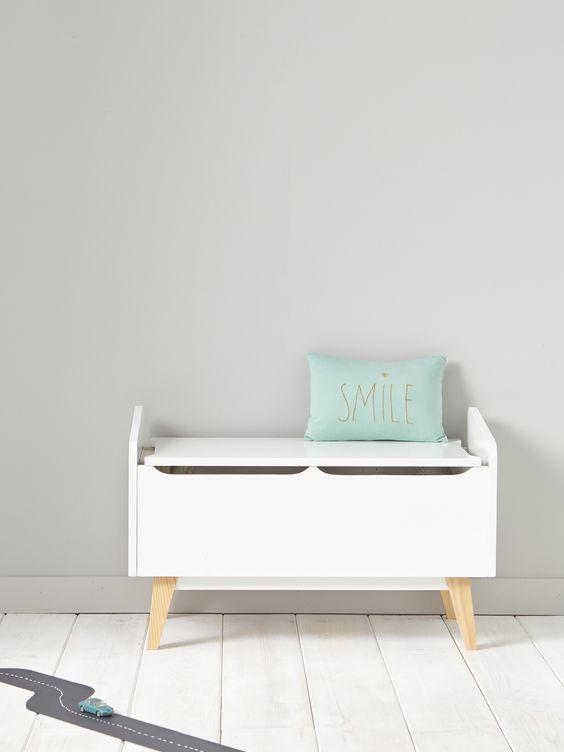 white wooden boxes, brown legs, white wooden floor, white wall
