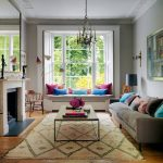 Window Seat, White Bench, Grey Cushion, Colorful Pilows, White Window, Wooden Floor, Brown Rug, Grey Sofa, Wooden Coffee Table