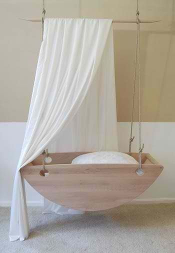 wooden bed swing with curve bottom, white canopy, white wall