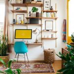 Wooden Floating Shelves, Wooden Floating Table, Green Modern Chair, Wooden Floor, White Wall, Yello Framed Door, Wooden Cabinet