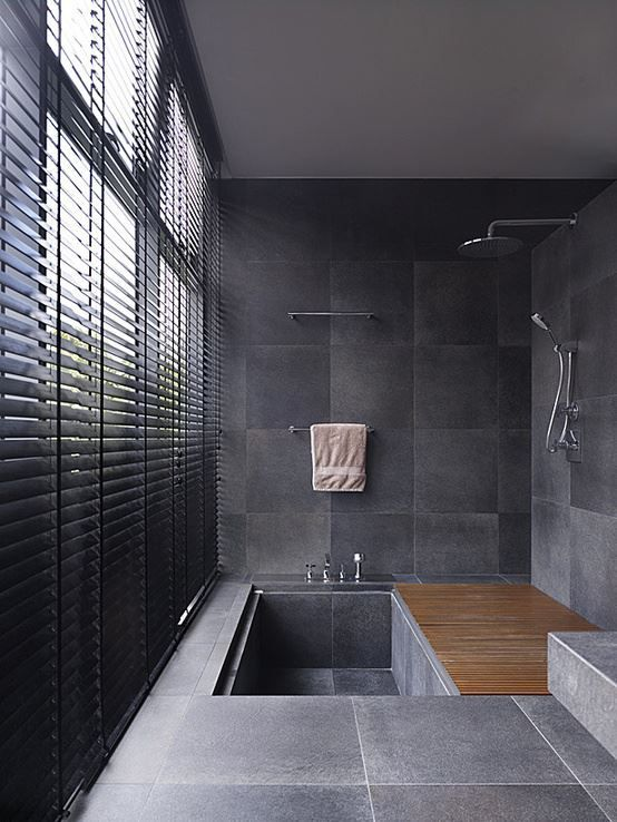 bathroom, black wall tiles, black floor tiles, silver faucet, wooden shower floor, windows